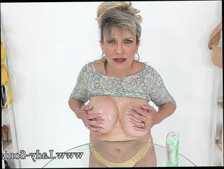 Mature lady oils his cock