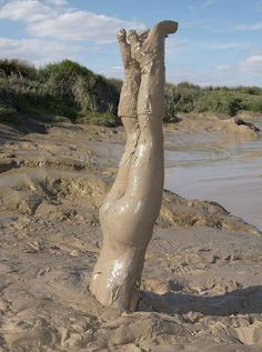Nude girls covered in mud